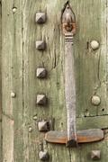 detail of an old door and mediaval - stock photo