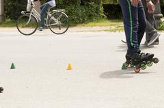 slalom with Inline skates - stock photo