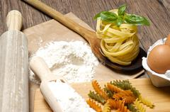 Pasta and ingredients for pasta - stock photo