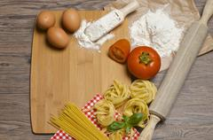 Pasta and ingredients for pasta Stock Photos