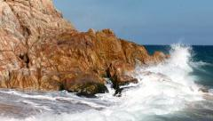 Waves crashing and breaking on a rocky coast Stock Footage