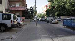 Small street in quiet neighborhood in white city Tel-Aviv Stock Footage