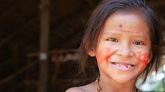 Native Brazilian girl looking to the camera at an indigenous tribe in the Amazon Stock Footage