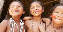 Native Brazilian children playing at an indigenous tribe in the Amazon Arkistovideo