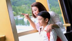 Young asian mother with little son stand on deck of cruise ship. Stock Footage