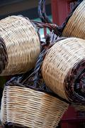 .Group of handmade baskets straw attached to the door Stock Photos