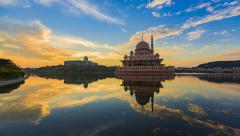 Timelapse Of Fiery Sunrise At Putra Lake overlooking the Putra Mosque Stock Footage