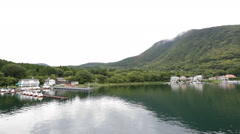 Wide angle while boating around HAKONE lake in JAPAN on sunny day. Stock Footage