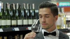 Sommelier examining wine - stock footage