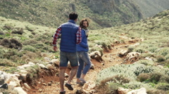 Young couple walking, hiking mountains, slow motion shot at 240fps Stock Footage