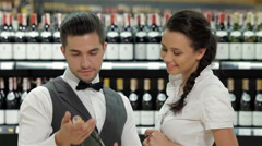 Sommelier giving woman recommendation Stock Footage