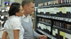Couple selecting wine in supermarket Stock Footage