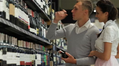 Couple at wine store Stock Footage