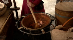 Stirring a medieval pot - stock footage