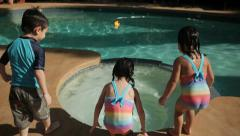3 KIDS ATTEMPT TO JUMP INTO A JACUZZI SLOW MOTION - stock footage