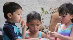 Cute Hispanic Kids Snack in Slow Motion - stock footage