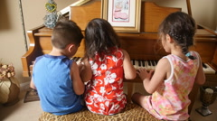 3 KIDS PLAY THE PIANO IN SLOW MOTION. Stock Footage