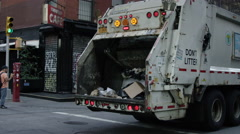 DSNY garbage truck with fanelli's cafe building SoHo 4K slow motion, NYC - stock footage