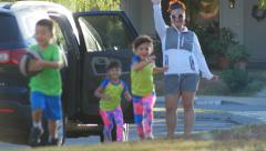 MOM DROPS KIDS OFF AT SOCCER PRACTICE SLOW MOTION Stock Footage