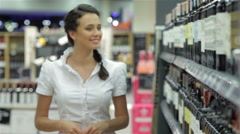 Young woman shopping wine - stock footage