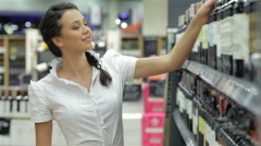 Casual woman taking bottle of wine - stock footage