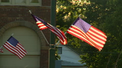 Flags in small town summer sun Stock Footage