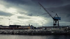 Crane Near Water In Dramatic Industrial Landscape Stock Footage