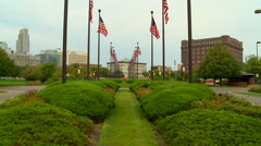 American Flags with Omaha Skyline Stock Footage