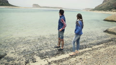 Young couple standing by sea and admire view, slow motion shot at 240fps - stock footage