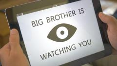 4K Big Brother Is Watching You Tablet Screen Stock Footage