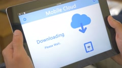 4K Downloading From Cloud Tablet Device Stock Footage
