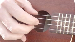 Finger picking ukulele strings Stock Footage
