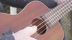 Ukulele pluck and strum Stock Footage
