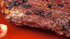 Meat over white : grlled meat shoulder on red plate Stock Footage