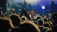 Slow motion big crowd at concert cheering clapping hands - stock footage