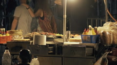 Slow motion fast food cart stand at street at night people passing by Stock Footage