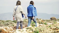 Two girlfriends walking, hiking mountains, slow motion shot at 240fps Stock Footage