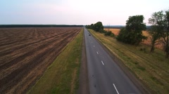 The car rides on the highway. Shooting from a helicopter Stock Footage