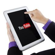 Hand touching tablet screen with youtube symbol Kuvituskuvat