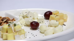 Cheese plate rotating On White Background Stock Footage