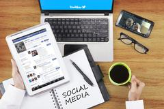 Person opens social media site with gadget - stock photo