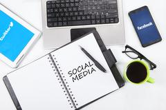 Social media logo on the tablet and smartphone Stock Photos