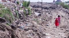 Little children walk on landfills. Stock Footage
