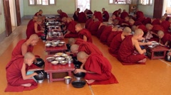 Many monks in red robes. - stock footage