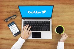 Twitter logo on the laptop and businessman hands Stock Photos