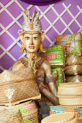 Bamboo offering boxes and traditional ceremonial balinese man figure Stock Photos