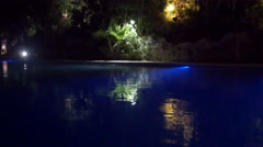 Beautiful night view of Mexican resort pool Stock Footage