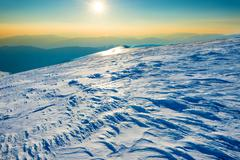 Bright sun in winter mountains - stock photo