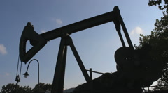 Pumpjack silhouette in Germany with Oil industry - stock footage