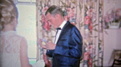 1968: Nervous man goes on high school prom date. - stock footage